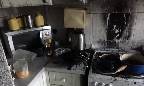 Fire damage to a small kitchen