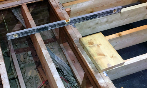 Spirit level on exposed timber suspended floor